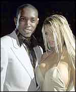 Dwight Yorke with glamour model Jordan