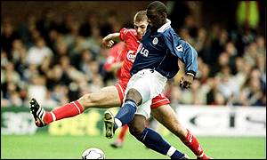Leicester's Trevor Benjamin is tackled by Steven Gerrard of Liverpool