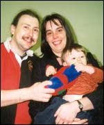 Darren and Carol Warburton, and 14-month-old Philip