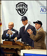 NYSE chairman Richard Grasso, Arnold Schwarzenegger and Time Warner CEO Gerald Levin