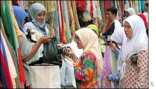 Women shop for cloth in a market