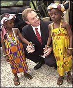 Blair meets local children in the village of Kyebi, Akyem Abuakwa, Ghana