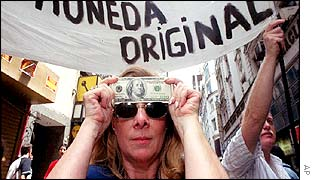 Demonstrator displays a $100 note