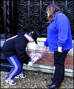 Flowers are laid outside Sandringham Estate