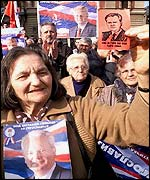 Serb woman holding a picture of former Yugoslav President Slobodan Milosevic