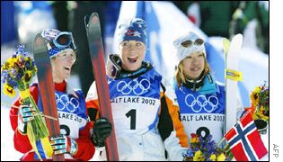 Gold Medal winner Kari Traa is flanked by second-placed Shannon Bahrke and bronze medalist Tee Satoya