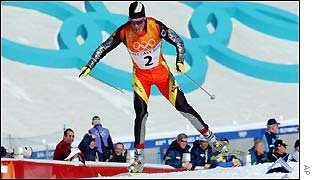 Spain's Johann Muehlegg grabs gold in the men's 30km cross-country skiing at the Winter Olympics.-