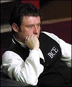 Jimmy White waits for his chance to pot a few balls