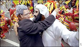 Couple wearing masks of President Bush and Osama Bin Laden
