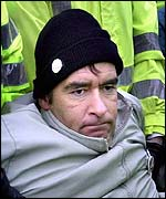 Tommy Sheridan carried away by police