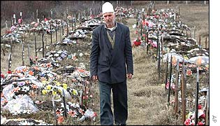 Milazim Hetemi, a survivor of a massacre in the central Kosovo village of Izbica walks in the graveyard