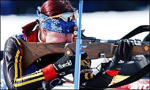 Andrea Henkel takes aim during the biathlon