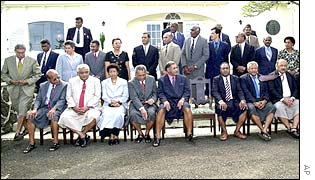 Prime Minister Laisenia Qarase takes a seat with his new government in September 2001