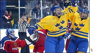 Erika Holst and Kristina Bergstrand celebrate Sweden's opening goal in their victory over Russia