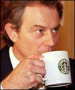PM Tony Blair enjoys a coffee