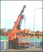 The crane fell into the site