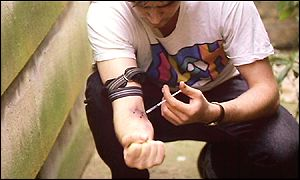 A drug user injects