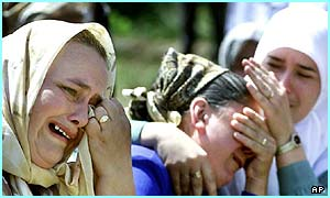 Bosnian Muslim women cry at a war memorial service