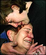 Idith Rothstein, the twin sister of slain Israeli Keren Rothstein, comforts her mother Aviva