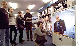 People in a Belgrade television shop watch the live broadcast