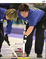 Sweden's Louise Marmont and Elisabeth Persson in action