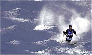 Richard Gay of France hurtles down the moguls run