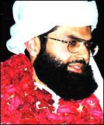Sheikh Omar wearing a garland seen in a photo dated 16 November 2000