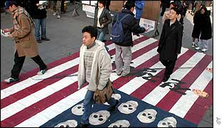 Anti-US protesters in Seoul walking on a US flag