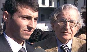 Chomsky (right) with publisher Fatih Tas outside court