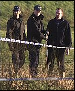 Police search the golf course