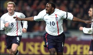 Darius Vassell wheels away in delight after scoring England's equaliser