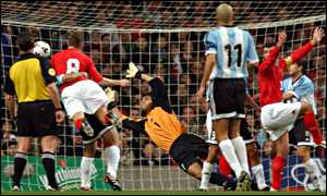 Wales striker Craig Bellamy scores against Argentina