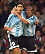 Argentina's Julio Cruz is congratulated by Claudio Caniggia after scoring