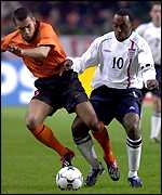 Giovanni van Bronckhorst (left) and Darius Vassell