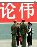 Falun Gong members being questioned by the police near Tiananmen Square in Oct 1999