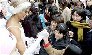Jai Williams (L), a dancer from New York-base all-male classical ballet company Trockadero de Monte Carlo, greets fans  in Tokyo