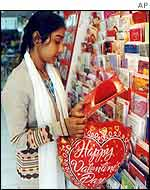 Young woman buying Valentine's card