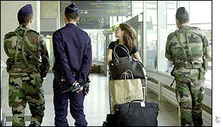 French police and soldiers patrol Charles de Gaulle airport