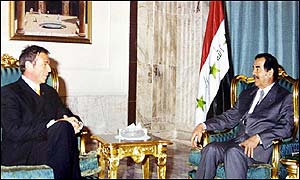 Joerg Haider (left) and Saddam Hussein during the talks in Baghdad