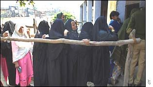 Women voters queue up at a polling station in Uttar Pradesh