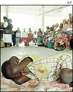 Boy awaits malaria vaccine in Mozambique