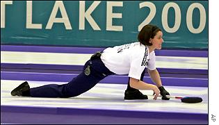 Great Britain's Deborah Knox slides past the hog line following the line of her stone during an Olympic game