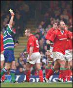 Wales skipper Soctt Quinnell is yellow carded by referee David McHugh