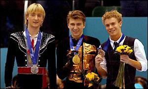 Russia's Alexei Yagudin (centre) celebrates winning the gold medal with silver medallist Russia's Evgeni Plushenko (left) and Timothy Goebel