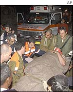 Paramedics evacuate one of the soldiers who was injured in the blast