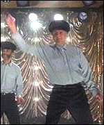 Practising the striptease in The Full Monty