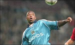 Leon Mike in action for Manchester City
