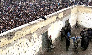Crowds surround the walls of the Afghan football stadium