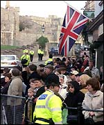 Members of the public gather outside Windsor Castle