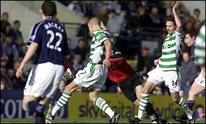 Larsson slides in the opening goal for Celtic